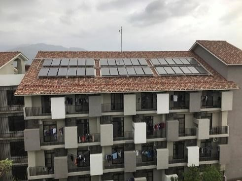 Solar thermal systems on the roof of building A, B, and C of the Second Student Dormitory on Zhiben campus that provide warm bath water year round. (Taitung University)