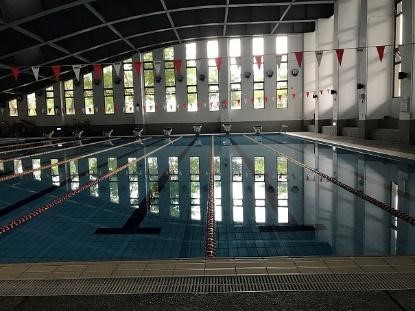 A heat pump system (consist of 2 heat pump units, middle) used to warm up the swimming pool (left) year round at Zhiben campus. The water temperature dashboard of each unit (right). (Taitung University)